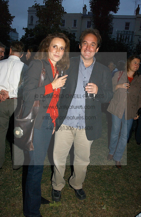 TV presenter JONATHAN MAITLAND and his wife at a party to celebrate the publication of Notting Hell by Rachel Johnson held in the gardens of 1 Rosmead Road, London W11 on 4th September 2006.<br />