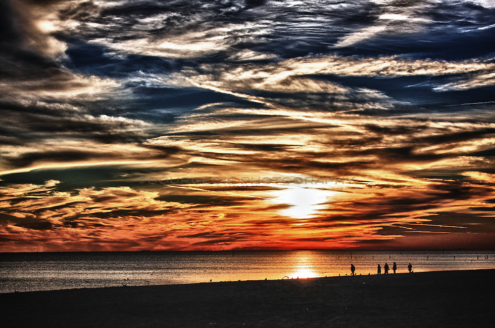 Beautiful beach sunset along the Mississippi Gulf Coast, near the Biloxi Lighthouse.