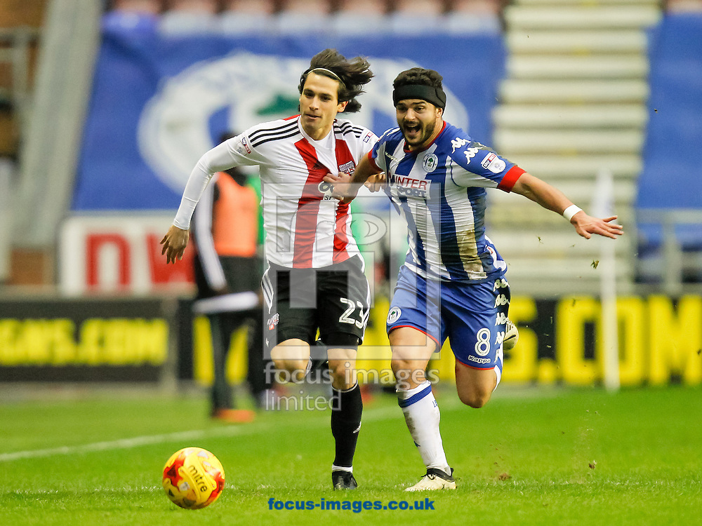 Jota of Brentford and Sam Morsy of Wigan Athletic during the Sky Bet Championship match between Wigan Athletic and Brentford at the DW Stadium, Wigan<br /> Picture by Mark D Fuller/Focus Images Ltd +44 7774 216216<br /> 21/01/2017