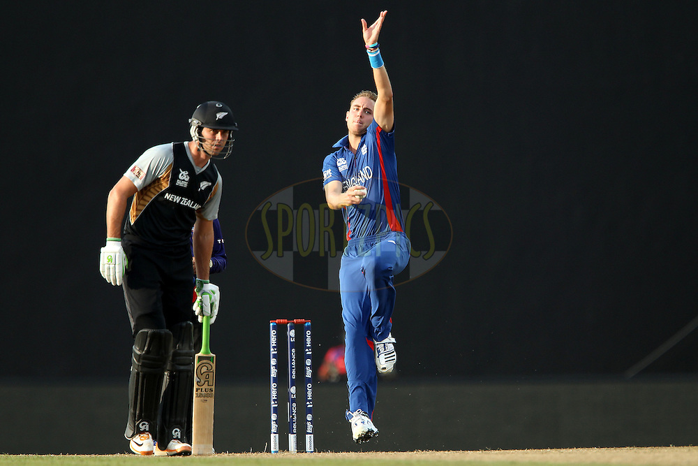 Stuart Broad (Captain) of England bowls as James Franklin prepares to run during the ICC World Twenty20 Super 8s match between England and New Zealand held at the  Pallekele Stadium in Kandy, Sri Lanka on the 29th September 2012..Photo byRon Gaunt/SPORTZPICS/PHOTOSPORT