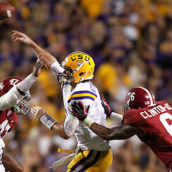 November 3, 2012; Baton Rouge, LA, USA;  LSU Tigers quarterback Zach Mettenberger (8) throws as Alabama Crimson Tide defensive back Ha'Sean Clinton-Dix (6) and linebacker Xzavier Dickson (47) pressure during a game at Tiger Stadium. Alabama defeated LSU 21-17. Mandatory Credit: Derick E. Hingle-US PRESSWIRE
