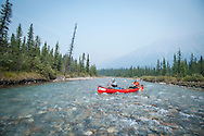 Zak Podmore and Jeff Moag canoeing the Bow River in Banff, Alberta.