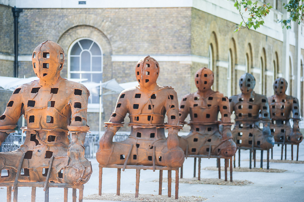 London, UK - 2 September 2014:  installation 'Guardians' by artist Xavier Mascaró. These rusted iron warriors, nearly 10 feet high, are both imposing and placid, and are inspired by medieval armour and ancient Egyptian and Greek art. Xavier Mascaró's first UK solo exhibition will run from 3 September until 5 October at Saatchi Gallery.