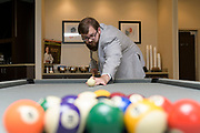 groom playing pool by Tallmadge wedding photographer, Akron wedding photographer Mara Robinson Photography