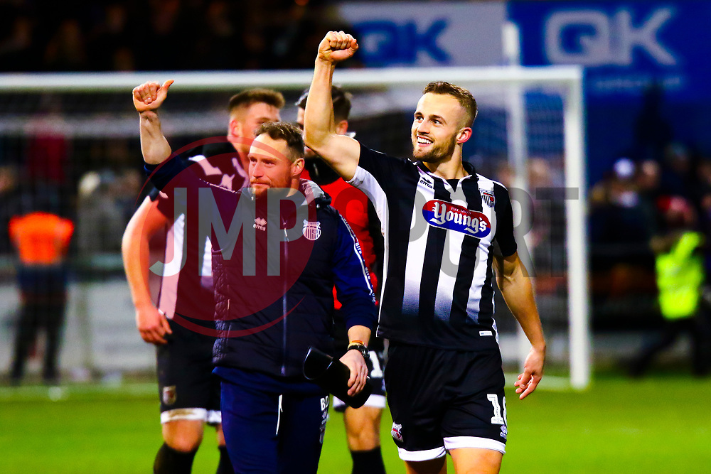Charles Vernam of Grimsby Town celebrates at full time - Mandatory by-line: Ryan Crockett/JMP - 04/01/2020 - FOOTBALL - One Call Stadium - Mansfield, England - Mansfield Town v Grimsby Town - Sky Bet League Two