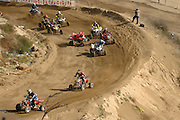 The second picture of the sequence of a crash at the ATVA MX National Feb 4-5, 2006 at Glen Helen.  The second picture shows (#4) Tim Farr up on 2 wheels as he crosses in front of (#55) Doug Gust.  Jones (#2) appears to have control of the bike but is actually falling off the bike.