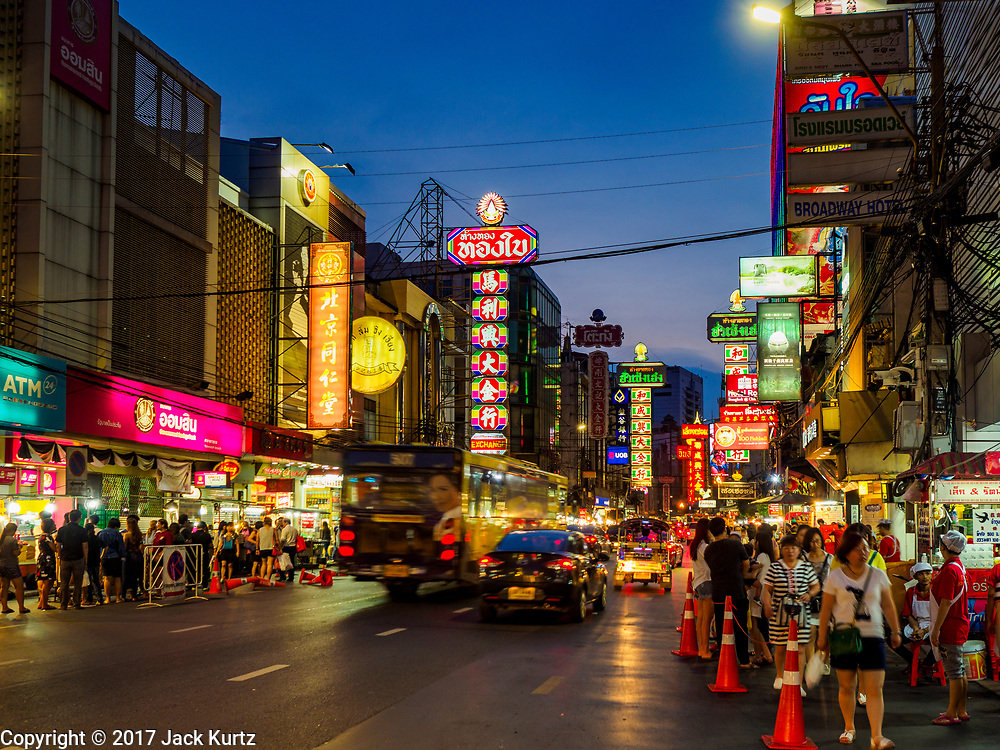 "18 MAY 2017 - BANGKOK, THAILAND:  Yaowarat Road in Bangkok's Chinatown is the heart of the city's street food industry. City officials in Bangkok have taken steps to rein in street food vendors. The steps were originally reported as a ""ban"" on street food, but after an uproar in local and international news outlets, city officials said street food vendors wouldn't be banned but would be regulated, undergo health inspections and be restricted to certain hours on major streets. On Yaowarat Road, in the heart of Bangkok's touristy Chinatown, the city has closed some traffic lanes to facilitate the vendors. But in other parts of the city, the vendors have been moved off of major streets and sidewalks.     PHOTO BY JACK KURTZ"