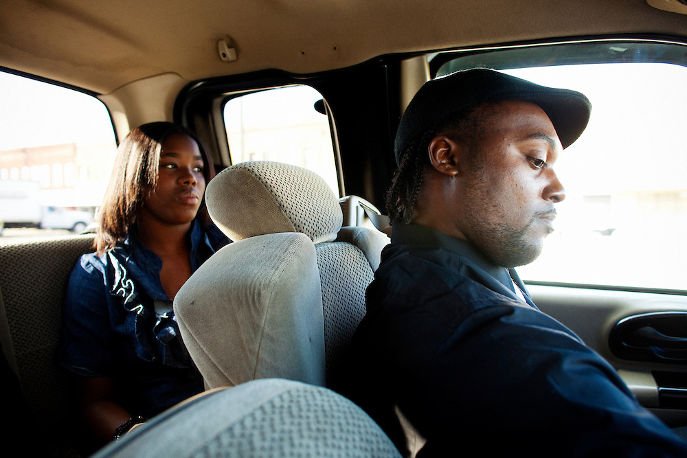"Nehemiah Hawkins drives a car full of mourners to the funeral of Demetrius ""Butta"" Anderson, 18, from the Baptist Town neighborhood of Greenwood, Mississippi on Friday, November 5, 2010."