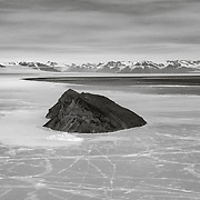 Inaccessible island and McMurdo Sound, with open water approaching as the sea ice breaks up.