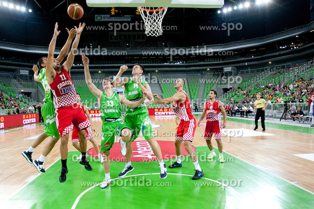 Jure Balazic of Slovenia and Krunoslav Simon of Croatia during friendly basketball match between National teams of Slovenia and Croatia of Adecco Ex-Yu Cup 2012 as part of exhibition games 2012, on August 4, 2012, in Arena Stozice, Ljubljana, Slovenia. (Photo by Urban Urbanc / Sportida)
