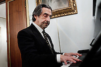 "ROME, ITALY - 12 MARCH 2013: Music director Riccardo Muti, 71, plays the piano in his dressing room during the second interval of  ""I Due Foscari"", an opera in three acts by Giuseppe Verdi, at the Teatro dell'Opera in Rome, Italy, on March 12, 2013... Riccardo Muti, Music Director of the Chicago Symphony Orchestra, has accepted the title of Honorary Director for Life of the Teatro dell'Opera in Rome...Gianni Cipriano for The New York Times"
