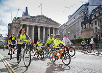 Riders pass the Royal Exchange and the Duke of Wellington statue as part of the Prudential RideLondon FreeCycle 29/07/2017.<br />