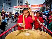 16 FEBRUARY 2018 - BANGKOK, THAILAND: A child drums for a lion dance troupe on Yaowarat Road during Chinese New Year celebrations in the Chinatown neighborhood of Bangkok. Thailand has a large Chinese community and Lunar New Year is widely celebrated, especially in larger cities. This will be the Year of the Dog.       PHOTO BY JACK KURTZ