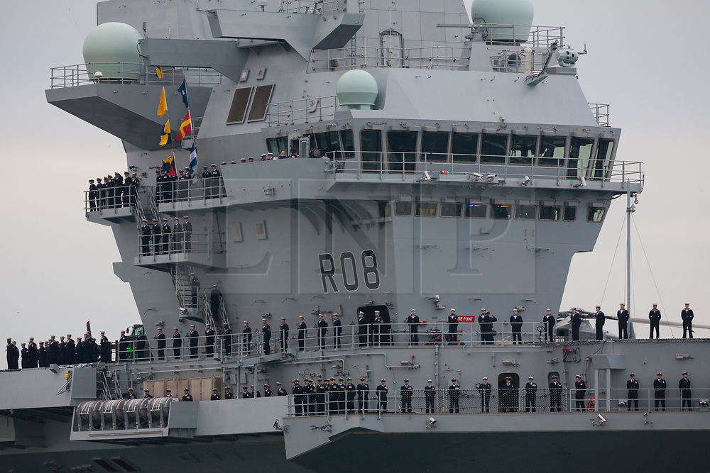 © Licensed to London News Pictures. 16/08/2017. Portsmouth, UK.  The Royal Navy's new aircraft carrier HMS Queen Elizabeth arrives into Portsmouth Harbour for the first time. Thousands of people lined the shores of Portsmouth and Southsea to welcome the Royal Navy's newest and largest ever ship into her home port. Photo credit: Rob Arnold/LNP