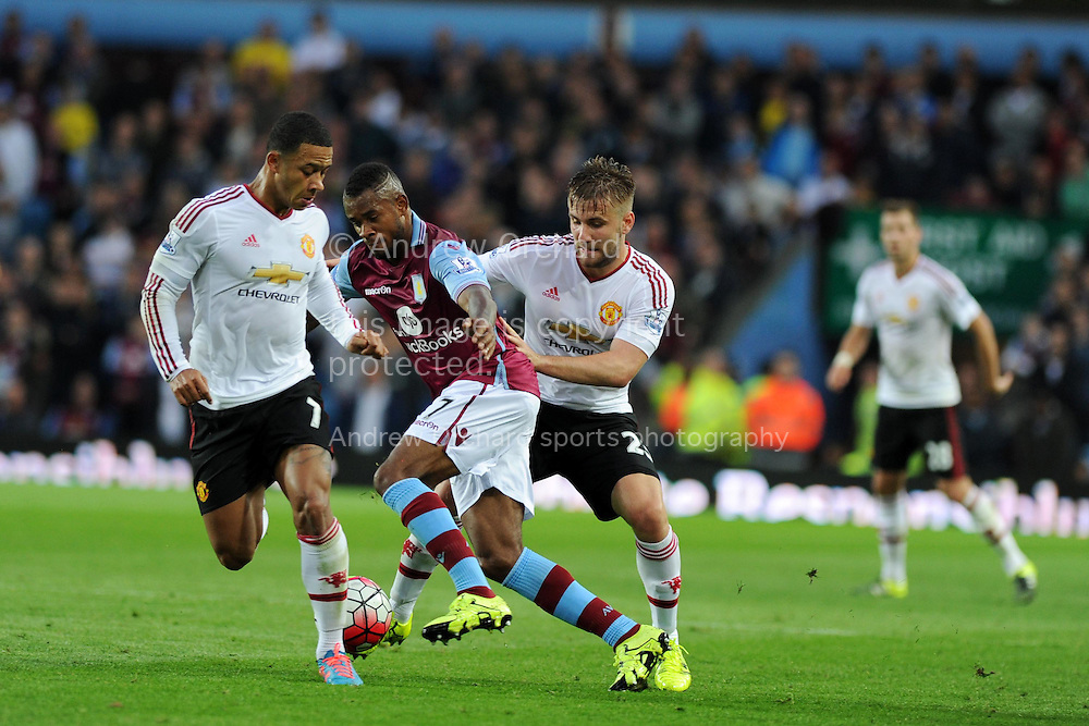 Leandro Bacuna of Aston Villa &copy; goes between Memphis Depay (l) and Luke Shaw of Manchester Utd. Barclays Premier League match, Aston Villa v Manchester Utd at Villa Park in Birmingham, Midlands on Friday 14th August  2015.<br /> pic by Andrew Orchard, Andrew Orchard sports photography.