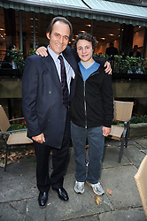TONY FITZJOHN and his son ALEX FITZJOHN at a party to celebrate the publication of Born Wild by Tony Fitzjohn at The Arts Club, Dover Street, London on 16th September 2010.