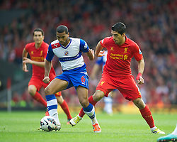 LIVERPOOL, ENGLAND - Saturday, October 20, 2012: Liverpool's Luis Alberto Suarez Diaz in action against Reading's Adrian Mariappa during the Premiership match at Anfield. (Pic by David Rawcliffe/Propaganda)