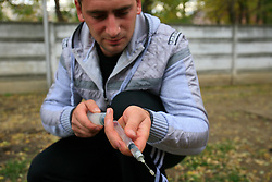 ROMANIA ONESTI 28OCT12 - An anaesthesist prepares his blow darts at the Onesti zoo in order to tranquilise a wolf in captivity. The zoo has been shut down due to non-adherence with EU regulations on the welfare of animals...The bear was rescued from the decrepit Onesti Zoo where it lived for 8 years in degrading conditions.......jre/Photo by Jiri Rezac / WSPA......© Jiri Rezac 2012