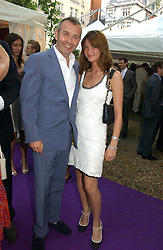 Club owner PIERS ADAM with his wife SOPHIE at The Summer Ball in Berkeley Square , Londin W1 in aid of the Prince's Trust on 6th July 2006.<br />