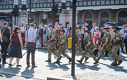 **CAPTION CORRECTION - Soldiers are walking past Charring Cross Station in Westminster**<br /> &copy; Licensed to London News Pictures. 25/05/2017. London, UK. Armed soldiers and police walk past commuters at Charring Cross Station in Westminster, London following a terrorist attack in Manchester, northern England, earlier this week. 23 people were killed an dozens more injured when Salman Abedi set off a suicide bomb at an Ariana Grande concert.  Photo credit: Ben Cawthra/LNP