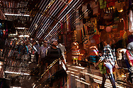 Busy street scene inside the medina, old town, with people shopping, November 6, 2017, Marrakech, Morocco. Double exposure image. Editorial use only.