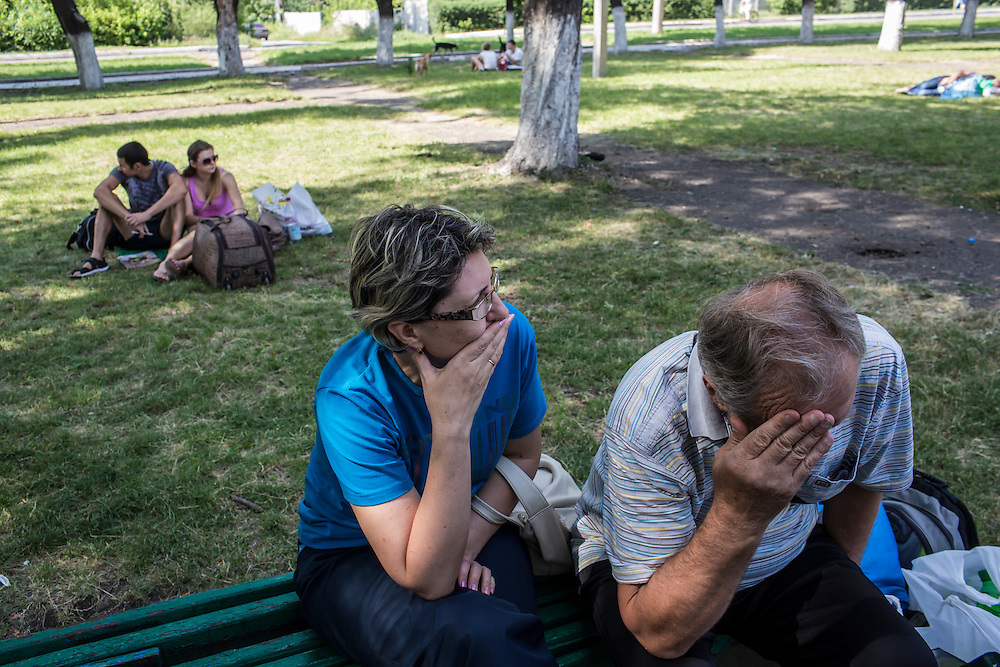 A couple from Horlivka wait for a train away from areas with heavy fighting on Monday, July 28, 2014 in Yasinovataya, Ukraine.