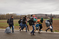 Greece, Idomeni<br /> <br /> A group of refugees with their children are on their way to Idomeni. They walk a long distance with little food and water. Carrying blankets and small luggage.<br /> <br /> Refugees from Syria, Irak, Afghanistan and others from the near east are trying to reach the border between Greece and Macedonia (FYROM). <br /> The train station in Idomeni, is the eye of a needle for getting to northern Europe. <br /> The FYROM (Macedonia) authorities, closed the border to Greece completely. The situation close to the border gets more and more difficult. The People have to sleep outside or in small tents. <br /> Heavy rainfalls and cold nights are treating the refugees badly. There is not enough food and supplies to help about 14.000 refugees. March 2016<br /> <br /> Keine Veroeffentlichung unter 50 Euro*** Bitte auf moegliche weitere Vermerke achten***Maximale Online-Nutzungsdauer: 12 Monate !!