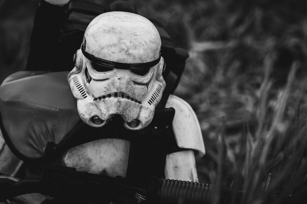 A Stormtrooper patrols in the forests of a distant planet.