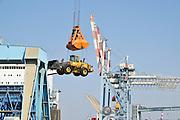Israel, Haifa, Haifa port crane hoisting a tractor