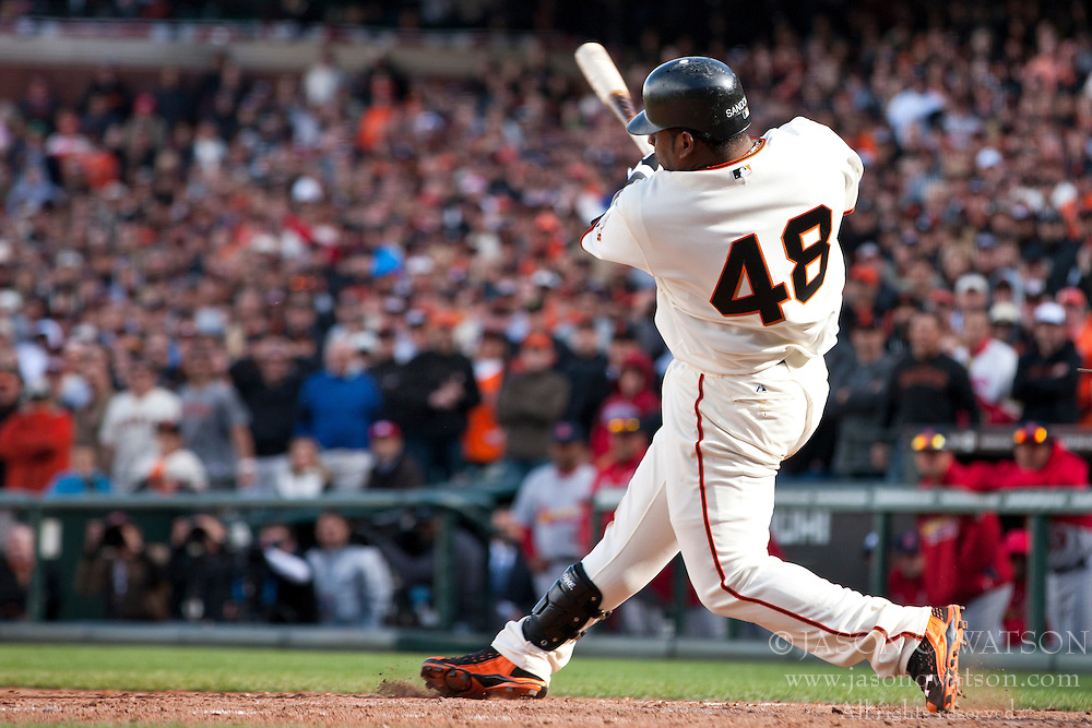 April 8, 2011; San Francisco, CA, USA;  San Francisco Giants third baseman Pablo Sandoval (48) hits an RBI single against the St. Louis Cardinals during the ninth inning at AT&T Park.