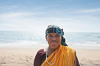 Portrait of mature Indian woman smiling at Vagator Beach