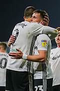 Fulham forward Aleksandar Mitrović (9) celebrates with Fulham defender Joe Bryan (23) after scoring a goal (3-1) during the EFL Sky Bet Championship match between Fulham and Luton Town at Craven Cottage, London, England on 23 October 2019.