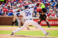 March 29, 2018 - Arlington, TX, U.S. - ARLINGTON, TX - MARCH 29: Texas Rangers starting pitcher Cole Hamels (35) pitches during the game between the Texas Rangers and the Houston Astros on March 29, 2018 at Globe Life Park in Arlington, Texas. Houston defeats Texas 4-1. (Photo by Matthew Pearce/Icon Sportswire) (Credit Image: © Matthew Pearce/Icon SMI via ZUMA Press)