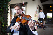Amey and Matt Sanders celebrate their wedding with family and friends at the Fallbrook Golf Club of California in Fallbrook, California, on July 12, 2014. (Stan Olszewski/SOSKIphoto)