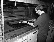 Pye Ireland,Factory,fridge assembly line..1971..15.04.1971..04.15.1971..15th April 1971..The Pye factory which manufactured electrical appliances closed its doors in 1985. At the peak it Pye employed 1200 people and was the largest employer in the Dundrum area. Dundrum bowl was built on the Pye site when the factory closed, it too had its problems and closed in the early 90s due to flooding. on the site now stands the Dundrum Shopping centre which is now the centrepoint of Dundrum town centre..This picture shows an operative preparing the hydraulic moulding machine,which formed the liner for the fridges.