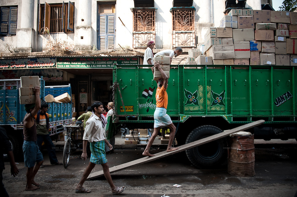 uploading a truck at Kolkata's fruit market
