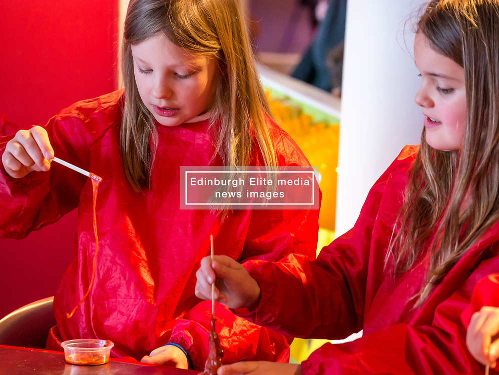 City Arts Centre, Edinburgh, Scotland, United Kingdom, 9 April 2019. Edinburgh Science Festival:  India and Lucy, age 8 years, have fun learning about blood at the Blood Bar drop in event at the Science Festival. <br /> <br /> Sally Anderson | EdinburghElitemedia.co.uk