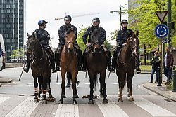 May 26, 2019 - Brussels, Belgium - Belgian police officers of the mounted brigade are watching the demonstrators during a demonstration against the European Institutions organised by the Yellow Vests movement and anti-fascist demonstrators but banned by the authorities, which took place in front of the Brussels North Station on Sunday 26 May 2019, voting day in the European elections. (Credit Image: © Samuel Boivin/NurPhoto via ZUMA Press)