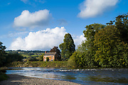 Riverside home in typical Welsh landscape by the River Wye in the Brecon Beacons in Wales, UK