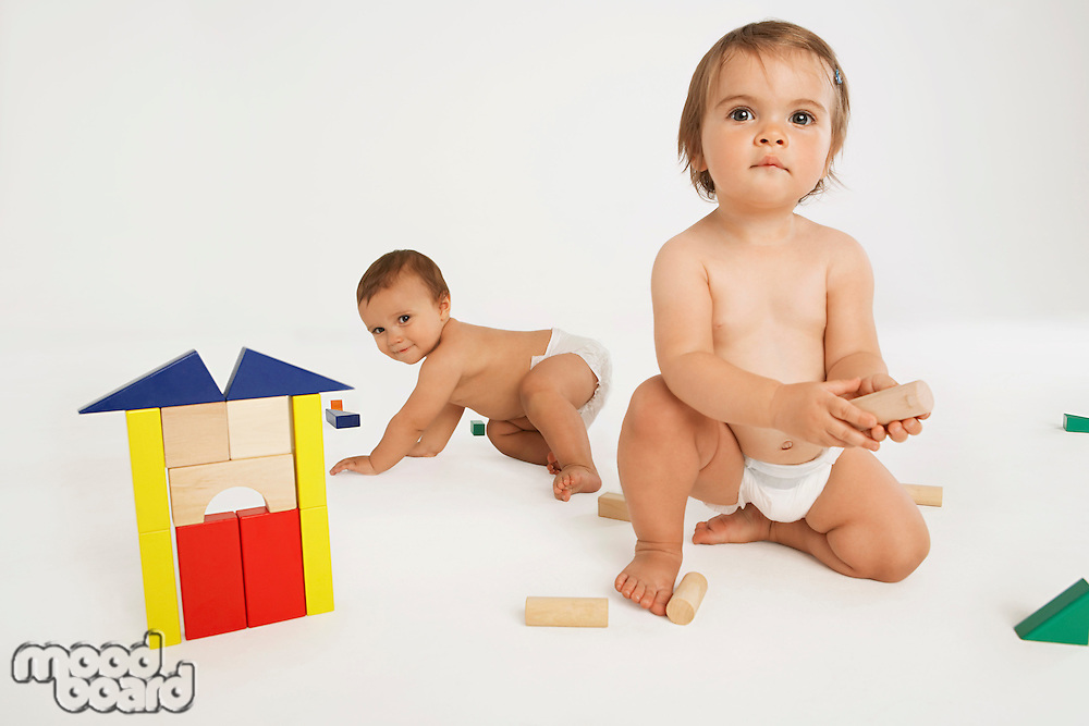 Baby Boy and Girl Playing With Building Blocks