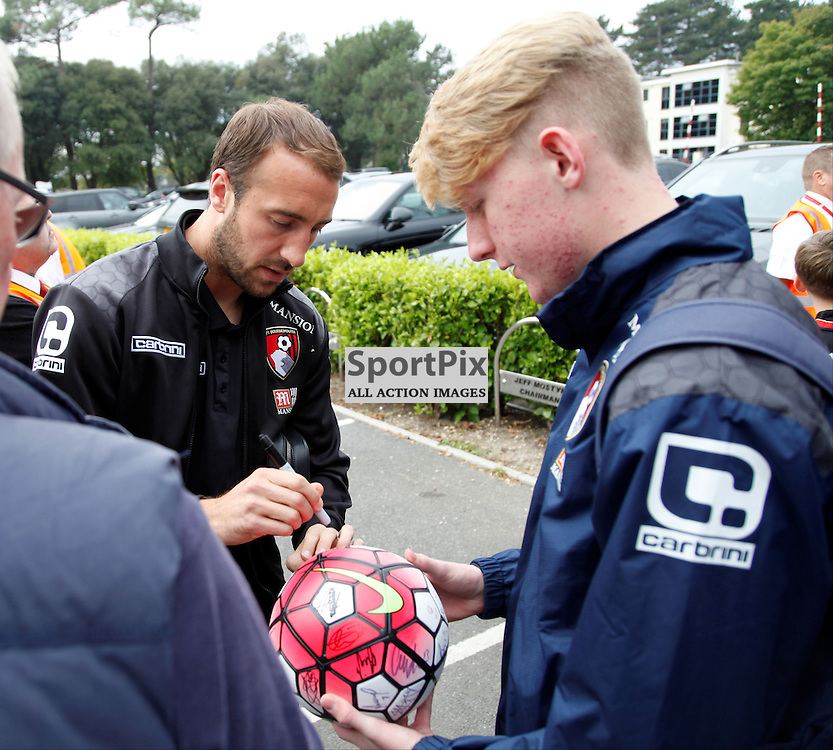 Glen Murray signs a fans football before Bournemouth vs Watford on Saturday 3rd of October 2015.