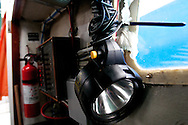 April 27, 2011 - A flash light hangs in the engine room of the Margaret M in Sandwich MA.