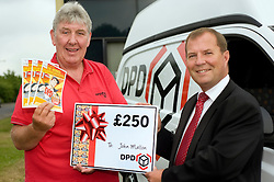 DPD Owner Driver Franchisee John Mallon receives a gift voucher for £250 from Regional Manager Steve Church  at the DPD distribution centre  at Thorncliffe Chapeltown Sheffield 14  July 2010 .Images © Paul David Drabble.