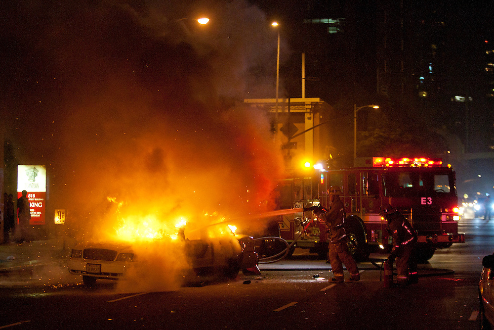 Los Angeles City Firefighters extinguish a taxi cab engulfed in flames as fans of the Los Angeles Lakers get out of hand following the team's victory in the 2010 NBA Finals Championship against the Boston Celtics near the Staples Center in Los Angeles California, USA, 17 June 2010.