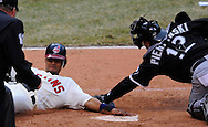 Franklin Gutierrez slides into home on a 3-run double by Casey Blake in the eighth inning Monday, March 31 at Progressive Field in Cleveland. The Indians defeated the White Sox 10-8.