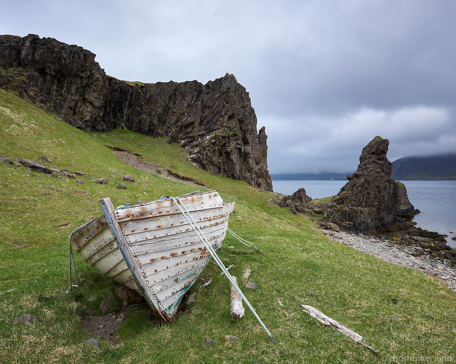 Old boat on land by Bergið in Norðurfjörður. Strandir, Northwest Iceland.
