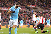 Manchester City forward Sergio Aguero  limps away after scoring during the Barclays Premier League match between Sunderland and Manchester City at the Stadium Of Light, Sunderland, England on 2 February 2016. Photo by Simon Davies.