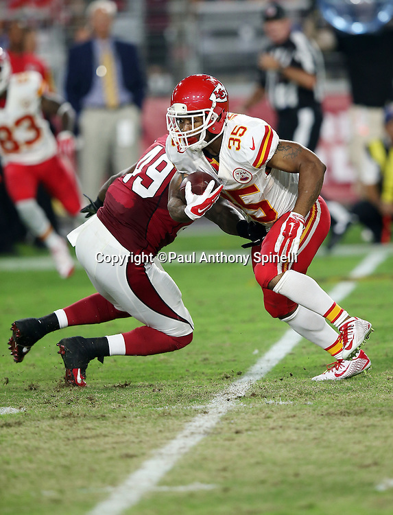 Kansas City Chiefs running back Charcandrick West (35) runs the ball in the fourth quarter during the 2015 NFL preseason football game against the Arizona Cardinals on Saturday, Aug. 15, 2015 in Glendale, Ariz. The Chiefs won the game 34-19. (©Paul Anthony Spinelli)