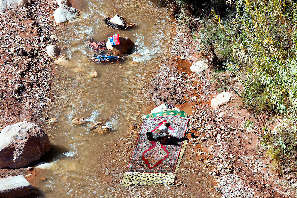 Women washing capets in the river, Ounila Valley.