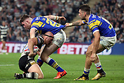 Leeds Rhinos loose forward Cameron Smith (27) is pulled back by his shorts by a team mate during the Betfred Super League match between Hull FC and Leeds Rhinos at Kingston Communications Stadium, Hull, United Kingdom on 19 April 2018. Picture by Mick Atkins.